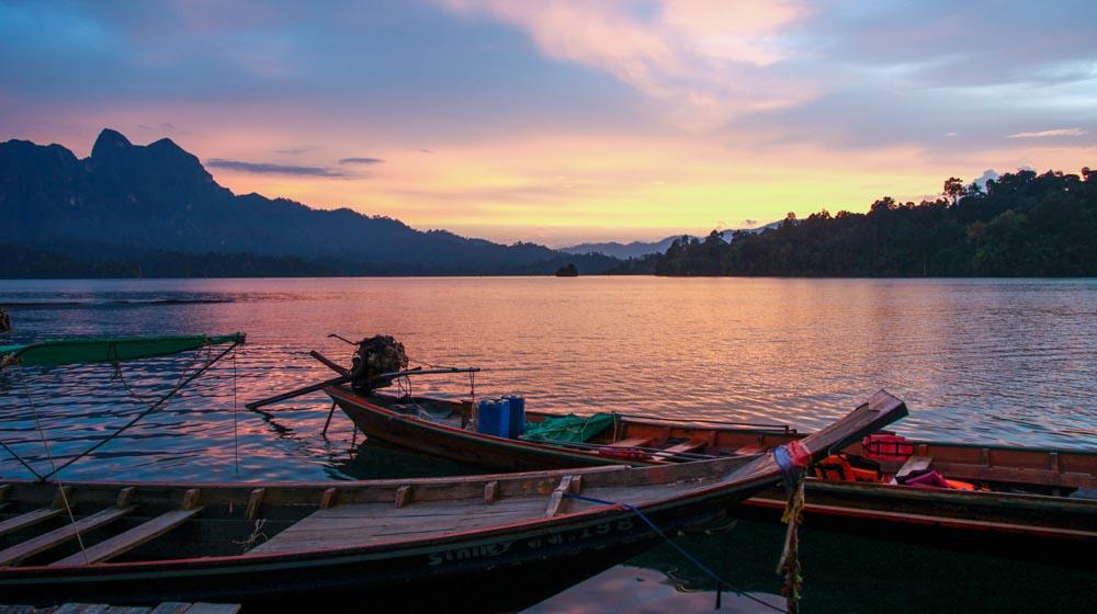 khao sok sunset on boats
